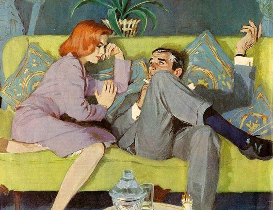 Чоловк і жінка сидять на дивані і розмовляють